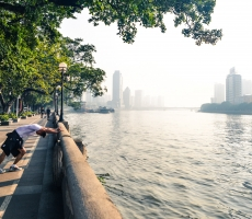 A man does his daily morning jog along the promenade of Zhujiang River in Guangzhou, China