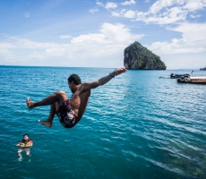 A young man jumps in to the sea ,Krabi,THailand