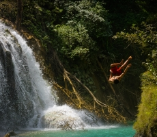 Jumping into Quang Xi waterfall