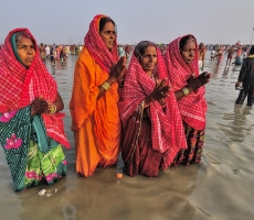 The Chhat Pilgrims after having a dip in the holy river Ganga, seeking blessings from the almighty.