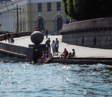 The picture was taken in Saint-Petersburg on a hot day, when the people sought to the river to cool off a bit.
