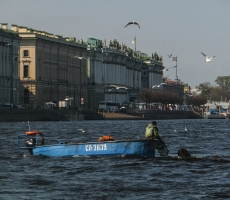 The picture shows fishermen caught in the river Neva famous fish Lamprey. This is a rare fish that are caught right in the heart of St. Petersburg.