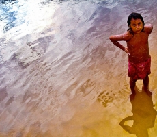 Yanomami indian girl baths in the Orinoco River