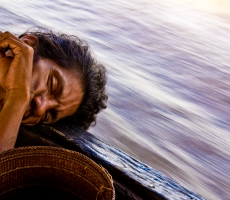 Venezuelan sailor sleeps in the wood boat.