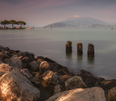 Sunset on Lago di Garda, Sirmione, a view on Monte Pastello and Lago di Garda, Italy. May 2014