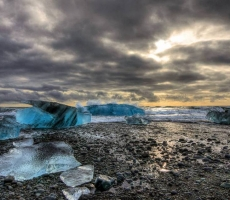 Icebergs on Black Sand Beach, Iceland.  The icebergs wash ashore but never remain more than a few hours. Salt water dissolves fresh.