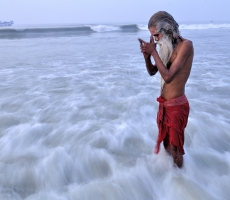 A sadhu offering his prayers after taking bath in the salt waters at The Ganga Sagar.