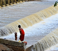 Mother and child taking bath in River dam